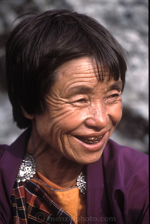 (MODEL RELEASED IMAGE). Nalim, 53, family matriarch and wife of Namgay. (Supporting image from the project Hungry Planet: What the World Eats.) Her teeth are discolored from years of chewing betal nut. The Namgay family living in the remote mountain village of Shingkhey, Bhutan, is one of the thirty families featured, with a weeks' worth of food, in the book Hungry Planet: What the World Eats.