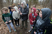 NWA Democrat-Gazette/ANDY SHUPE<br /> Robin Buff of Fayetteville (center) plays birdsongs Thursday, March 14, 2019, for a group of students from Butterfield Trail Elementary School who were on a field trip to learn about birds at the Botanical Garden of the Ozarks. Gifted and talented students from Fayetteville Public Schools spent the day at the gardens learning about ornithology through instruction from garden volunteers and district teaching staff.