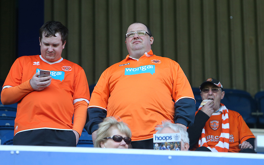 Blackpool's Fans<br /> Photo by Kieran Galvin/CameraSport<br /> <br /> Football - The Football League Sky Bet Championship - Queens Park Rangers v Blackpool - Saturday 29th March 2014 - Loftus Road - London<br /> <br /> &copy; CameraSport - 43 Linden Ave. Countesthorpe. Leicester. England. LE8 5PG - Tel: +44 (0) 116 277 4147 - admin@camerasport.com - www.camerasport.com