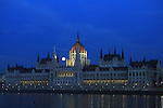 Dec 31, 2009 - Budapest, Hungary - The last full moon of this year behind of the Hungarian Parliament, just a few hours before a partial eclipse, visible from Europe, Africa and Asia. Credit Aristidis Vafeiadakis/ZUMA Press