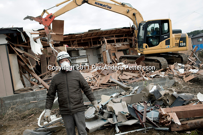 HIGASHI, JAPAN - DECEMBER 2: Yoshimito Sugawara works to clear rubble and tear down a house destroyed residential area still not being cleared eight months after the tsunami on December 2, 2011, in Higashi, Japan. The small town was almost wiped off the map during the tsunami Northeastern Japan's coastline was struck by an earthquake measuring 9.0 on the Richter scale and a Tsunami on March 11, 2011 which destroyed villages and livelihoods for hundreds of thousands of people. Almost 16,000 dead, thousands missing, more than 700,000 properties destroyed and an estimated 387,000 survivors lost their homes. Its estimated that it will take more than five years to rebuild. The cost is estimated to 309 billion U.S. dollars, the world's most expensive natural disaster. Many children suffered especially with school destroyed, education interrupted and the loss of family members took a heavy toll. (Photo by Per-Anders Pettersson)