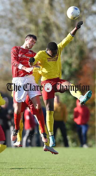 David O Grady of Newmarket Celtic A in action against Nzube Okyre of Avenue United A during their FAI Junior Cup fourth round game at Mc Donough Park. Photograph by John Kelly.