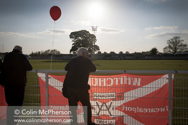 A spectator watching the pre-match warm-up at Yockings Park before Whitchurch Alport hosted Cammell Laird 1907 in the 2017-18 North West Counties Division One play-off final. Alport were formed in 1946 and were named after Alport Farm, Whitchurch, which had been the home of a local footballer Coley Maddocks who had been killed in action in the war. The home team won the match 2-1 watched by a crowd of 773, a club record attendance.