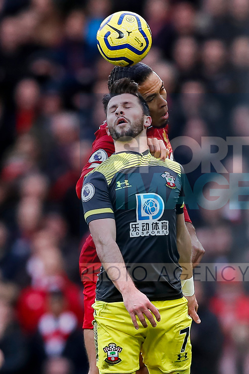 Shane Long of Southampton and Virgil Van Dijk of Liverpool battle for the ball during the Premier League match at Anfield, Liverpool. Picture date: 1st February 2020. Picture credit should read: James Wilson/Sportimage