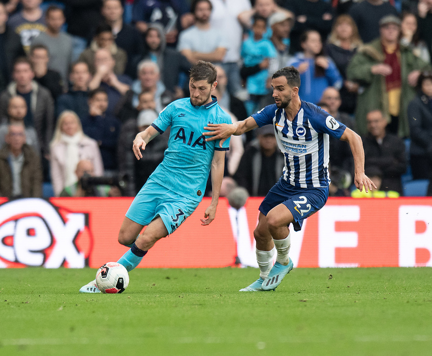 Brighton & Hove Albion's Martin Montoya (right) battles with Tottenham Hotspur's Ben Davies (left)<br />  <br /> Photographer David Horton/CameraSport<br /> <br /> The Premier League - Brighton and Hove Albion v Tottenham Hotspur - Saturday 5th October 2019 - The Amex Stadium - Brighton<br /> <br /> World Copyright © 2019 CameraSport. All rights reserved. 43 Linden Ave. Countesthorpe. Leicester. England. LE8 5PG - Tel: +44 (0) 116 277 4147 - admin@camerasport.com - www.camerasport.com