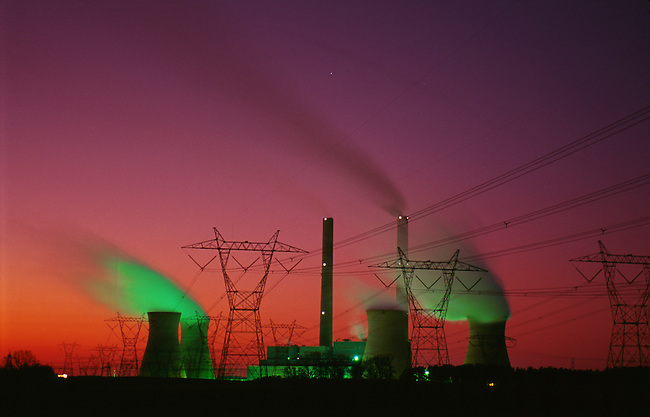 Flourescent lighting illuminates steam rising from the cooling towers of a Georgia Power coal powered electric plant in Georgia. Photo shot in 1994.