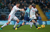 Matt Bloomfield of Wycombe Wanderers holds off Conor Henderson of Crawley Town during the Sky Bet League 2 match between Wycombe Wanderers and Crawley Town at Adams Park, High Wycombe, England on 25 February 2017. Photo by Andy Rowland / PRiME Media Images.