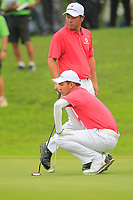 Phachara Khongwatmai (Asia) and Hideto Tanihara (Asia) on the 9th green during the Friday Foursomes of the Eurasia Cup at Glenmarie Golf and Country Club on the 12th January 2018.<br /> Picture:  Thos Caffrey / www.golffile.ie