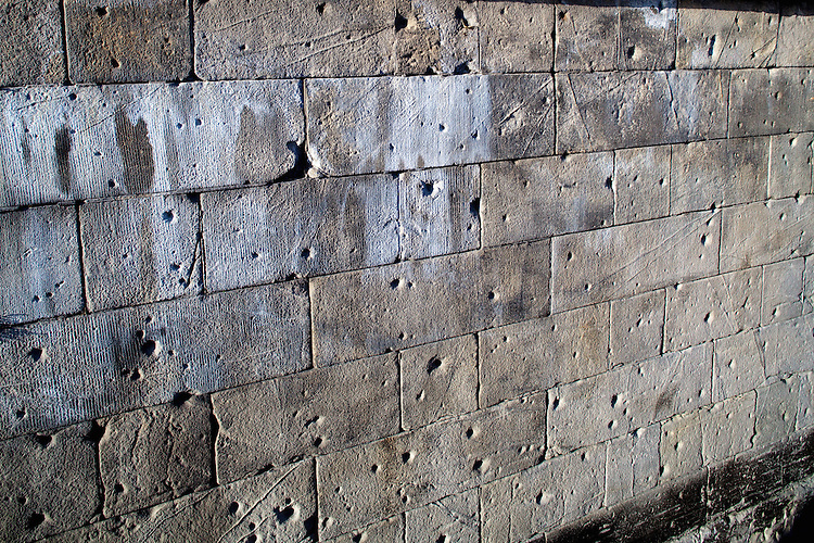 World War II bullet holes on the walls of the Spree river bank, Berlin, Germany
