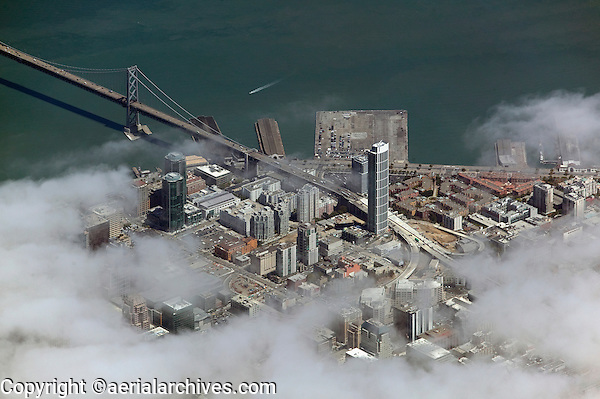 aerial photograph One Rincon Hill tower fog San Francisco, California