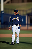 AZL Brewers Blue manager Raphael Neda (18) walks across the field after an argument with the first base umpire during an Arizona League game against the AZL Athletics Gold on July 2, 2019 at American Family Fields of Phoenix in Phoenix, Arizona. AZL Athletics Gold defeated the AZL Brewers Blue 11-8. (Zachary Lucy/Four Seam Images)
