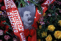MINSK, BELARUS - MAY: 9 A portrait of Joseph Stalin rests on flowers placed at the base of a war memorial during Victory Day celebrations on May 9, 2004 in Minsk, Belarus. For years, Belarus was frozen in its communist past. Now the radical change that has swept the former Soviet Union -- from Georgia's 2003 popular uprising to Ukraine's orange revolution last winter to the recent meltdown in Kyrgyzstan -- is catching up with President Alexander Lukashenko, a dictator whose regime has been described as Stalinism minus the Gulag. The images here capture a country and a people inexorably moving toward revolution: Student activists organizing illegally, democratic reformers meeting in rusting warehouses, protesters holding pictures of 'enemies of the state' murdered by the security services. Just beneath the apparent ordinariness and staidness of this post-Soviet republic, which is barely distinguishable from its former Soviet self, is a deep and powerful anger and a yearning for a new politics and a new possibility. That is the crux of Belarus today -- anger and yearning held together by the glimmer of a hope that tomorrow the regime may tumble. (Photo by Landon Nordeman)
