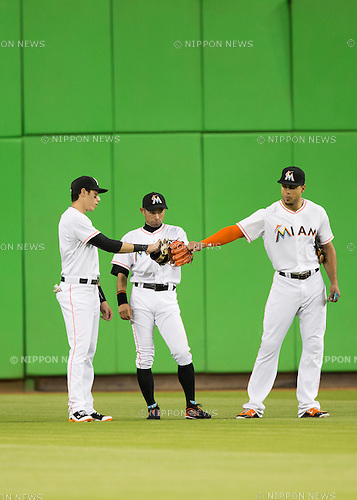 Christian Yelich, Ichiro Suzuki, Giancarlo Stanton (Marlins),<br /> MAY 19, 2015 - MLB : (L-R) Christian Yelich, Ichiro Suzuki and  Giancarlo Stanton of the Miami Marlins are senn during the Major League Baseball game against the Arizona Diamondbacks at Marlins Park in Miami, Florida, United States.<br /> (Photo by Thomas Anderson/AFLO) (JAPANESE NEWSPAPER OUT)