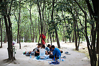 People play cards in Changle Park in Xian, Shaanxi Province, China.