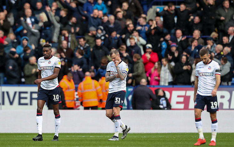 Dejected Bolton Wanderers' players Sammy Ameobi, David Wheater and Gary O'Neil after conceding their first goal<br /> <br /> Photographer Andrew Kearns/CameraSport<br /> <br /> The EFL Sky Bet Championship - Bolton Wanderers v Preston North End - Saturday 9th February 2019 - University of Bolton Stadium - Bolton<br /> <br /> World Copyright &copy; 2019 CameraSport. All rights reserved. 43 Linden Ave. Countesthorpe. Leicester. England. LE8 5PG - Tel: +44 (0) 116 277 4147 - admin@camerasport.com - www.camerasport.com