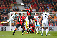 Joshua King of AFC Bournemouth (m) wins a header from Oliver Norwood of Sheffield United (l)  during AFC Bournemouth vs Sheffield United, Premier League Football at the Vitality Stadium on 10th August 2019