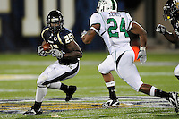 14 November 2009:  FIU cornerback Jonathan Cyprien (25) recovers a fumble in the second half as the FIU Golden Panthers defeated the North Texas Mean Green, 35-28, at FIU Stadium in Miami, Florida.