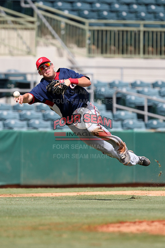Washington Nationals third baseman Justin Bloxom #9 throws to first during an Instructional League game against the Houston Astros at Osceola County Stadium on September 26, 2011 in Kissimmee, Florida.  (Mike Janes/Four Seam Images)