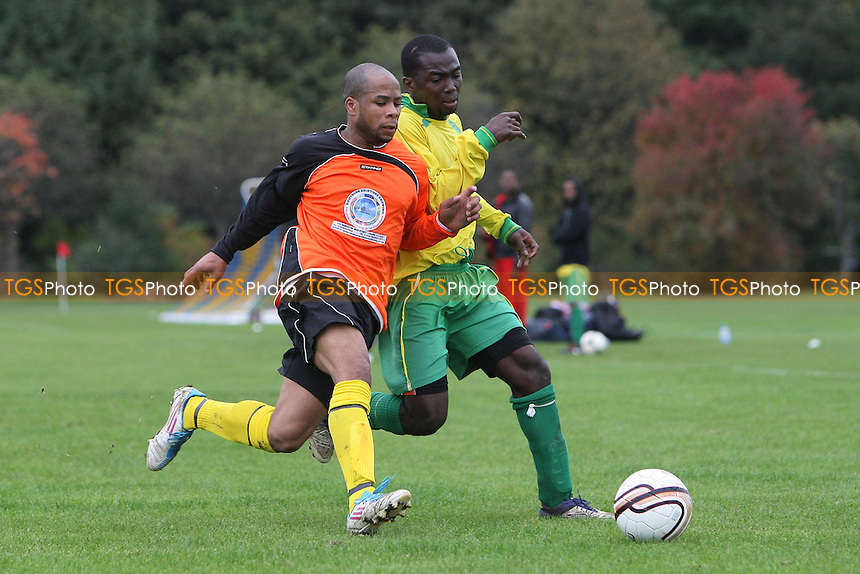 St Lucia United (orange) vs Hackney Downs A - East London Sunday League Football at South Marsh, Hackney Marshes, London - 21/10/12 - MANDATORY CREDIT: Gavin Ellis/TGSPHOTO - Self billing applies where appropriate - 0845 094 6026 - contact@tgsphoto.co.uk - NO UNPAID USE.