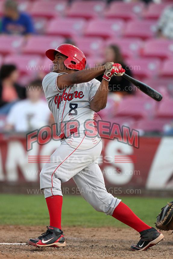 Spokane Indians catcher Yefry Castillo #8 bats against the Salem-Keizer Volcanoes at Volcanoes Stadium on August 10, 2011 in Salem-Keizer,Oregon. Salem-Keizer defeated Spokane 7-6.(Larry Goren/Four Seam Images)