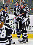 8 February 2009: University of New Hampshire Wildcats' defenseman Kacey Bellamy (22), a Senior from Westfield, MA, celebrates a goal by teammate forward Micaela Long (right), a Junior from South Boston, MA, against the University of Vermont Catamounts in the second game of a weekend series at Gutterson Fieldhouse in Burlington, Vermont. The Wildcats defeated the lady Catamounts 6-2 to sweep the 2-game series. Mandatory Photo Credit: Ed Wolfstein Photo