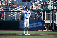 Everett AquaSox second baseman Cesar Izturis Jr. (40) celebrates after getting a hit during a Northwest League game against the Tri-City Dust Devils at Everett Memorial Stadium on September 3, 2018 in Everett, Washington. The Everett AquaSox defeated the Tri-City Dust Devils by a score of 8-3. (Zachary Lucy/Four Seam Images)
