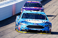 July 16, 2017 - Loudon, New Hampshire, U.S. - Kevin Harvick, Monster Energy NASCAR Cup Series driver of the Busch Beer Ford (4), heads into turn 1 at the NASCAR Monster Energy Overton's 301 race held at the New Hampshire Motor Speedway in Loudon, New Hampshire. Eric Canha/CSM
