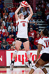 Wisconsin Badgers Janelle Gabrielsen (6) sets the ball during an NCAA volleyball match against the Michigan Wolverines at the Field House on October 30, 2010 in Madison, Wisconsin. Michigan won the match 3-1. (Photo by David Stluka)