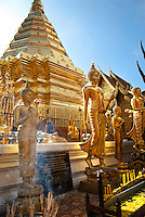 According to legend, Wat Pra That Doi Suthep was built high on a mountain overlooking Chiang Mai at the spot where a white elephant stopped with a miraculous Buddha relic before trumpeting three times and diying. In 1368 King Nu Naone ordered the construction of a temple at the site. Visitors to the temple can climb the 309 steps to reach the pagodas and golden chedi (stupa), or there is a tram up the hillside.