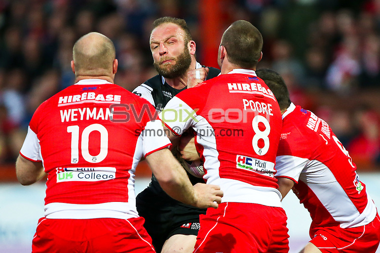 Picture by Alex Whitehead/SWpix.com - 17/04/2014 - Rugby League - First Utility Super League - Hull KR v Hull FC - KC Lightstream Stadium, Hull, England - Hull FC's Garreth Carvell is tackled by Hull KR's Michael Weyman, Justin Poore and Josh Hodgson.