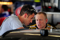 Jul. 3, 2008; Daytona Beach, FL, USA; Nascar Sprint Cup Series driver Aric Almirola (left) talks with teammate Mark Martin during practice for the Coke Zero 400 at Daytona International Speedway. Mandatory Credit: Mark J. Rebilas-