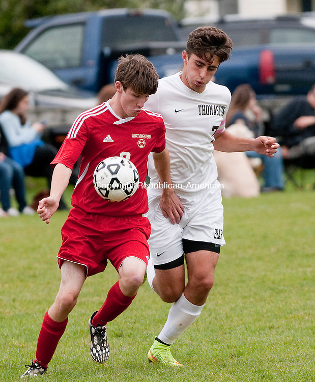 THOMASTON, CT-100714JS06-  Northwestern's Ben Moulton (3) gets control of the ball in front of Thomaston's Ardit Coma (7) during their game Tuesday at Highwood Farms Field in Thomaston. <br /> Jim Shannon Republican-American