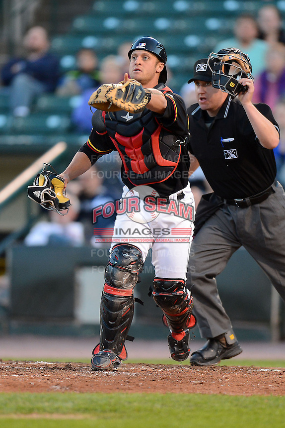 Rochester Red Wings catcher Dan Rohlfing #52 calls out a pop up in front of umpire Ryan Blakney during a game against the Scranton Wilkes-Barre RailRiders on June 19, 2013 at Frontier Field in Rochester, New York.  Scranton defeated Rochester 10-7.  (Mike Janes/Four Seam Images)