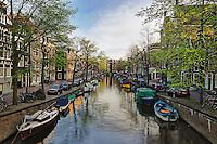 Boats along canal, Amsterdam, Holland, Netherlands