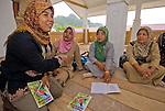 Zakiah Najdy and school teachers plan a kids' painting contest in Leupung village.