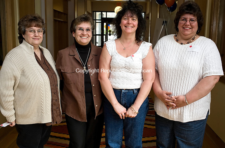 LITCHFIELD--27 April 2008--042908TJ10 - Janet Julian (Maville), 70, from left, with twin Joyce Bodnar, and Carol Rogers (Whalen), 46, with twin Coral Ozerhoski, all from Torrington, at the Charlotte Hungerford Hospital's 'Twintastic Reunion' in Litchfield on Sunday, April 27, 2008. (T.J. Kirkpatrick/Republican-American)
