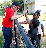 Billy Martin speaks with a pair of his former players before coaching a tee ball game on the old McCants field in Anderson. Martin, who started coaching his children's teams, has coached tee ball and baseball for the city's recreation leagues for about 30 years.