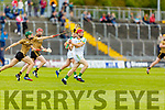 Kerry's Jordan Conway attempts to hook Offaly's Niall Houlihan in the Joe McDonagh Cup relegation game in Tralee on Saturday.