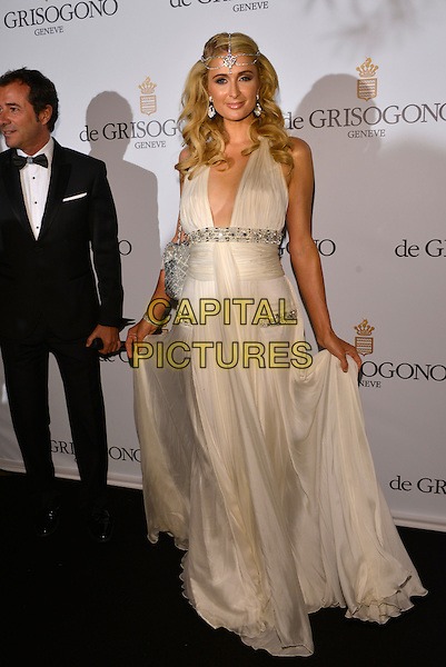Paris Hilton. 'De Grisogono' party arrivals at the Eden Roc, Hotel du Cap, Antibes during the 66th  Cannes Film Festival, France 21st May 2013.full length white dress silver sleeveless embellished jewel encrusted plunging neckline cleavage .CAP/PL.©Phil Loftus/Capital Pictures.