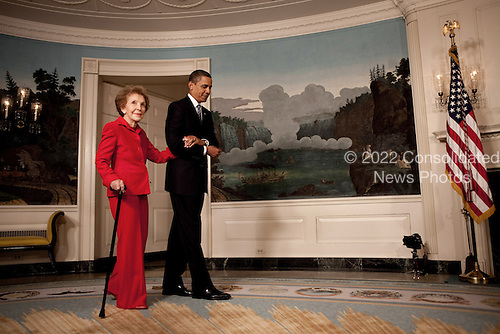 Washington, DC - June 2, 2009 -- United States President Barack Obama escorts former First Lady Nancy Reagan in the Diplomatic Room of the White House June 2, 2009, for the announcement and signing of the Ronald Reagan Centennial Commission Act--commemorating the late President's 100th Birthday in 2011. <br /> Mandatory Credit: Pete Souza - White House via CNP