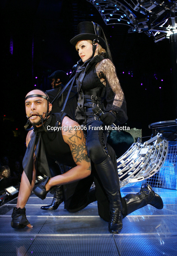 NEW YORK - JULY 02:  Madonna performs onstage at Madison Square Garden July 2, 2006 in New York City.  (Photo by Frank Micelotta/Getty Images)