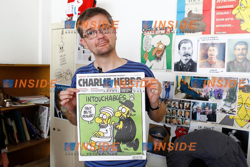 Charb (Directeur de la publication) .Parigi 19/9/2012.Charlie Hebdo, settimanale satirico francese, al centro di polemiche per la pubblicazione di vignette ritenute offensive su Maometto..Foto Insidefoto / Gwendoline Le Goff / Panoramic.ITALY ONLY
