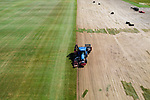 Pictured: A turf harvester leaves striking lines as it cuts up lawn turf for order on a field in Chandlers Ford, near Southampton, Hants. As one of the only growers of lawn turf in Hampshire, the family run business Solent Turf are the only people dismayed at the recent warm weather, as the lawn turf hasn't been recieveing the water it needs to properly green. The family are able to harvest over 30,000 square metres of lawn turf during peak season on the 30 acre field. <br /> <br /> The business shut down all operations for 4 weeks at the start of the lockdown and saw a decrease of 80% on trade sales but an increase of 60% from private buyers looking to landscape their garden during lockdown.  The turf is now once again being cut to order for garden centres.<br /> <br /> © Jordan Pettitt/Solent News & Photo Agency<br /> UK +44 (0) 2380 458800