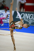 September 21, 2007; Patras, Greece;  Irina Kovalchuk of Ukraine turns pivot with hoop during the All-Around final at 2007 World Championships Patras. Irina was a giant hero for Ukraine at Patras... On this day she woke with a fever, said to be 39 Celcius and then single handedly qualified Ukraine to receive the 2nd of 2 positions for the individual All-Around competition at Beijing 2008 Olympics.  Photo by Tom Theobald. .