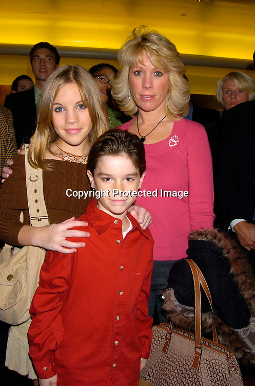 Kristen Alderson, Eddie Alderson and mom Kathy ..at the 12th Annual Gala for The League for the Hard of Hearing called Feast With Famous Faces on October 18, 2004 at JP Morgan Chase. ..Photo by Robin Platzer, Twin Images