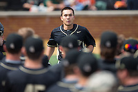 Stuart Fairchild (4) of the Wake Forest Demon Deacons is greeted by his teammates after hitting a solo home run against the Miami Hurricanes at Wake Forest Baseball Park on March 22, 2015 in Winston-Salem, North Carolina.  The Demon Deacons defeated the Hurricanes 10-4.  (Brian Westerholt/Four Seam Images)