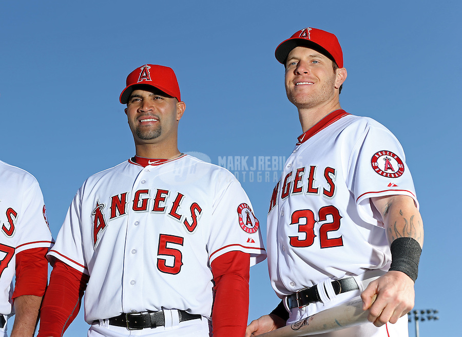 Feb. 21, 2113; Tempe, AZ, USA: Los Angeles Angels first baseman Albert Pujols (left) and outfielder Josh Hamilton pose for a portrait during photo day at Tempe Diablo Stadium. Mandatory Credit: Mark J. Rebilas-