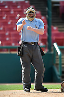 Umpire Brandon Butler makes a call during a game between the Burlington Bees and Kane County Cougars on August 20, 2014 at Third Bank Ballpark in Geneva, Illinois.  Kane County defeated Burlington 7-3.  (Mike Janes/Four Seam Images)