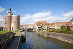 Drommedaris tower and attractive historic waterside buildings, Enkhuizen, Netherlands
