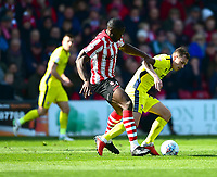 Lincoln City's John Akinde battles with  Cheltenham Town's Jordan Tillson<br /> <br /> Photographer Andrew Vaughan/CameraSport<br /> <br /> The EFL Sky Bet League Two - Lincoln City v Cheltenham Town - Saturday 13th April 2019 - Sincil Bank - Lincoln<br /> <br /> World Copyright &copy; 2019 CameraSport. All rights reserved. 43 Linden Ave. Countesthorpe. Leicester. England. LE8 5PG - Tel: +44 (0) 116 277 4147 - admin@camerasport.com - www.camerasport.com